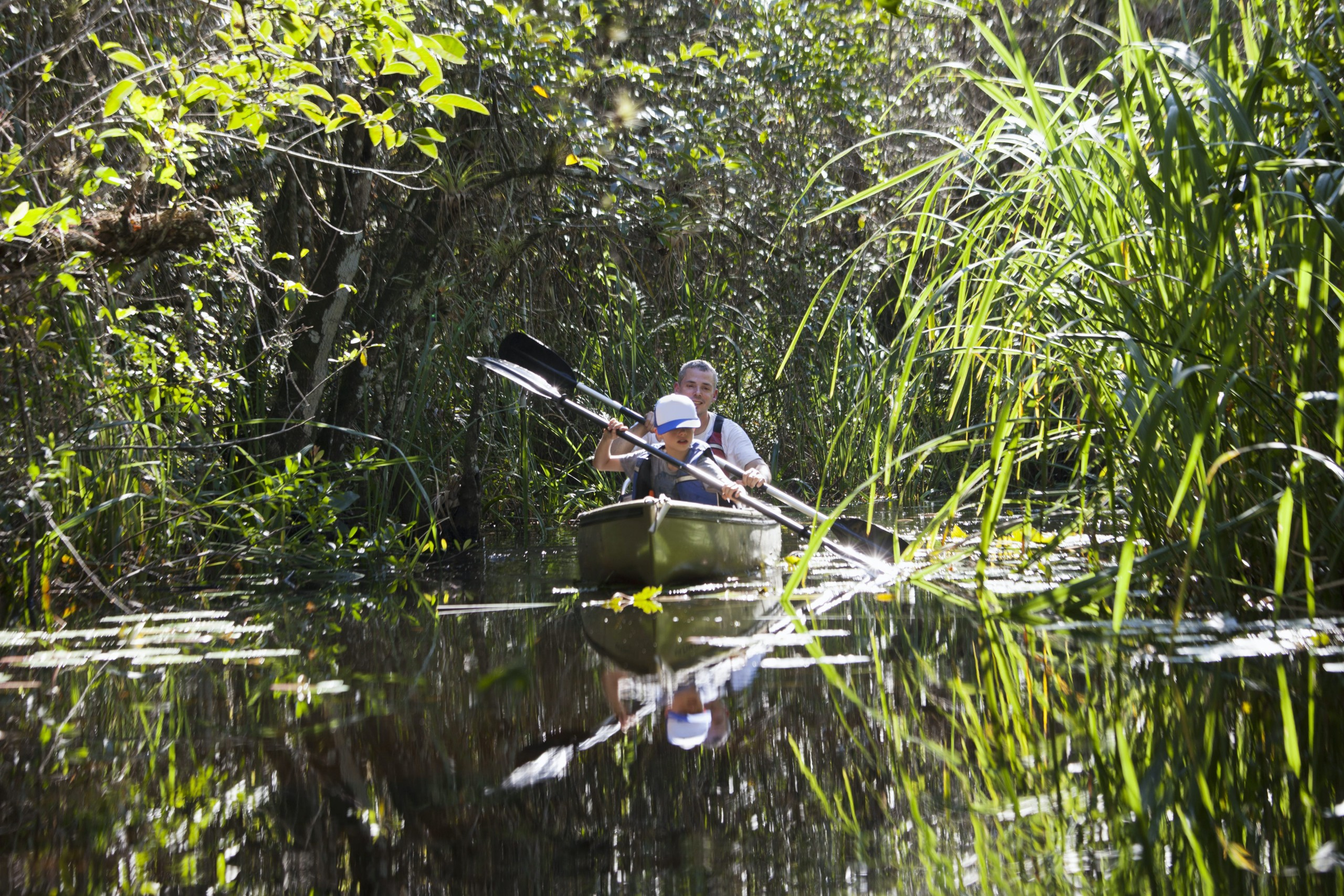 father and son canoe in Everglades