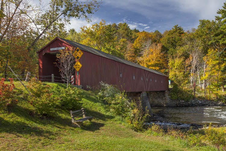 The picturesque covered bridge in West Cornwall, Connecticut. Image by Jeff Hunter / Photostock / Getty
